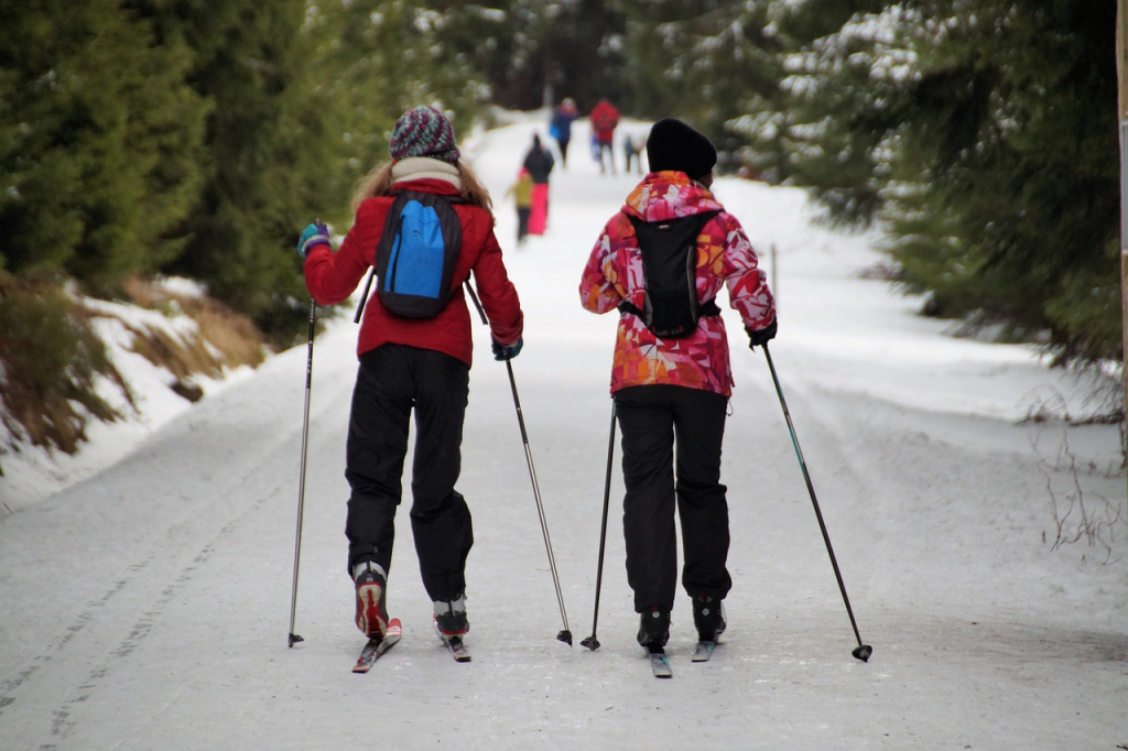 Cross-country skiers with hydration pack